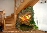 Пространство под лестницей можно эффективно использовать для размещения декоративного водопада.