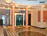 Дизайн водной панели подчинен идее классики, с колоннами и повторением круговых элементов в конструкции водопада.