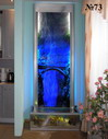 Еще один вариант рисунка. Фон в этом декоративном водопаде выполнен из мелкой плитки антрацитового цвета, перекликающейся с другими элементами интерьера. Прекрасный дизайн водопада.